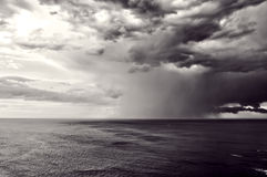 Downpour with stormy clouds. Downpour over sea with stormy clouds Royalty Free Stock Photography