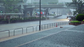 Downpour on the Streets of Hong Kong and Traffic stock video
