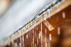 Downpour in the summer storm and rain drops on the roof.  Royalty Free Stock Photos