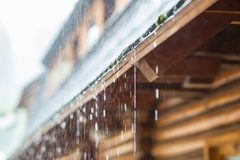 Downpour in the summer storm and rain drops on the roof.  Royalty Free Stock Image