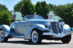 Downriver Cruise on Fort Street. A supercharged classic roadster cruises on Fort Street Royalty Free Stock Images