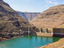 Downriver view of gorge and breakers at impressive Katse Dam hydroelectric power plant in Lesotho, Africa. Impressive Katse Dam hydroelectric power plant in Stock Photos