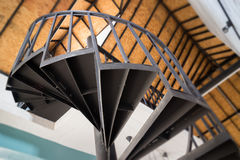 Downside view of a spiral staircase Stock Photo