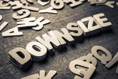 Downsize. Stack of wood letters as Downsize word Royalty Free Stock Image