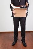 Downsized employee with belongings Stock Images