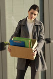 Downsizing. Young businesswoman losing her job due to corporate downsizing Stock Photo