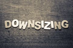 Downsizing. Topic by wood letters Royalty Free Stock Photography