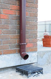 Downspout Gutter Installation with Rainwater Drainage System Installation. Royalty Free Stock Photo