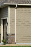Downspout on Residential Home. Downspout and Gutters on a Residential House royalty free stock photo