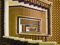 Downstairs. Staircase with carpet from a traditional hotel seen from above Royalty Free Stock Image