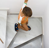 Downstairs. A child going downstairs aereal view Royalty Free Stock Images