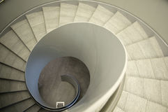 Downstairs a Staircase. Look down a modern spiral Staircase Royalty Free Stock Photos