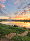 Downstairs to river. Sunrise landscape with slope to the river stock photography