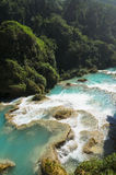 Downstream of a powerful river with turquoise pools surrounded by Stock Photography