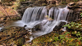 Downstream Waterfall on Black Rocks during Day Stock Photo