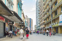 Downtowm Dar Es Salaam. Dar Es Salaam: April 24: Local residents walk around on the streets of Downtown Dar Es Salaam on April 24, 2015 in Dar Es Salaam Royalty Free Stock Photography