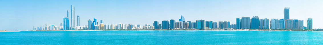 Downtown Abu Dhabi. A panorama photo of downtown Abu Dhabi, UAE, along the Corniche Road royalty free stock images