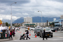 Downtown Anchorage Alaska Gloomy Sky. A typical Saturday morning view of downtown in July as people walk to the local Farmer's Market in Anchorage Alaska Royalty Free Stock Photo