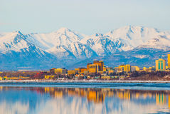 Anchorage City. Downtown Anchorage Alaska and its reflection into Cook Inlet Stock Photos
