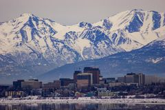 Downtown Anchorage, Alaska in the middle of the winter. Downtown Anchorage, Alaska with the Chugach Mountains in the background and Turnagain Arm in the Royalty Free Stock Image