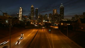 Downtown Atlanta Dusk Time Lapse. Downtown Atlanta skyline and time lapse highway traffic at dusk stock footage