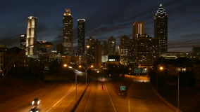 Downtown Atlanta Editorial Dusk Time Lapse with Zoom. Downtown Atlanta skyline and highway traffic time lapse with zoom stock video footage