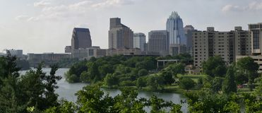 Downtown Austin. A panoramic view of downtown Austin, Texas with river and greenery Royalty Free Stock Image