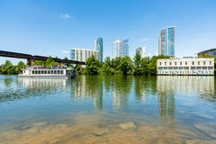 Downtown Austin Skyline. Austin, TX USA - April 14, 2016: Skyline view of downtown Austin along the Colorado River with tour boat cruising by Royalty Free Stock Photography