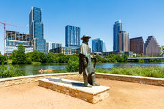 Downtown Austin Skyline. Austin, TX USA - April 14, 2016: Skyline view of the downtown district along the Colorado River with the statue of the late Stevie Ray Royalty Free Stock Photography
