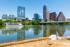 Downtown Austin Skyline. Austin, TX USA - April 14, 2016: Skyline view of  the downtown district along the Colorado River with a tour boat cruising by Stock Image