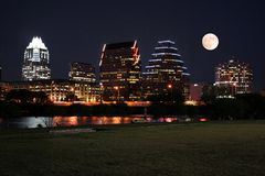 Downtown Austin, Texas at Night with Moon. A very pretty night in Austin, Texas.  This shot was taken from across Town Lake downtown.  A very useful image for Royalty Free Stock Photo