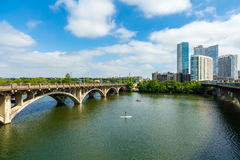 Downtown Austin Texas. Austin, TX USA - April 14: Skyline view of the downtown area along the Colorado River with a paddle boarder cruising by Royalty Free Stock Photography