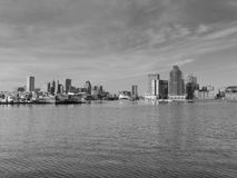 Downtown Baltimore and Harbor East skyline. The downtown Baltimore, Maryland skyline with the bay in the foreground Black and White royalty free stock photo