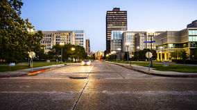 Downtown Baton Rouge, Louisiana Skyline. Street in downtown Baton Rouge, Louisiana as night falls - skyline stock photography