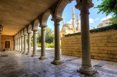 Downtown Beirut, Lebanon (4). The Mohammad Al-Amin Mosque situated in Downtown Beirut, in Lebanon as viewed through the pillars of the Greek Orthodox church of Stock Photography