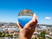 Downtown Bloemfontein through a solid glass ball. stock image