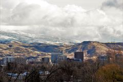 Downtown Boise on a winter day with snow capped mountains in the background. Cloudy skies royalty free stock image