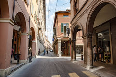 Street life Bologna. Old city of Bologna, Italy with arcades, shops and restaurants Stock Photos