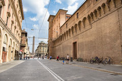Downtown Bologna. Old city wall of Bologna, Italy and houses with arcades, shops and restaurants Royalty Free Stock Photos
