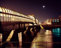 Downtown Bridge at Night. Night shot of downtown Waterloo, IA at night with moon Stock Photos