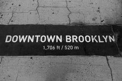 Downtown Brooklyn sign painted on floor in NY Stock Images