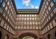 Downtown building, blue sky, inner court and lots of windows and arches, in Hamburg, Germany Royalty Free Stock Images