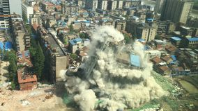 Downtown building demolition by implosion Stock Photo