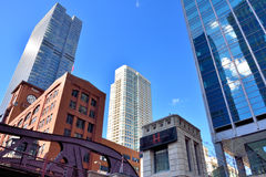 Downtown buildings stand beside Chicago River. City buildings and bridge on Chicago river, Chicago, Illinois, United States.nPhoto taken in October 6th, 2014 Stock Photos