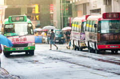 Downtown bus station with pedestrian while Typhoon Mujigae movin Royalty Free Stock Photo