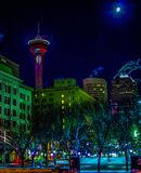 Downtown Calgary in Christmas Lights. Calgary tower and moon in the back ground royalty free stock photo