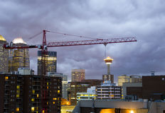 Downtown Calgary Construction. Construction is a common sight in. Calgary Skyline during thunderstorm. Construction on new condo building Royalty Free Stock Photo