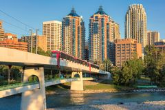 Downtown Calgary skyline on a summer sunset, Alberta, Canada. Calgary cityscape with Peace Bridge and downtown skyscrapers in Alberta at sunset, Canada Royalty Free Stock Image