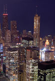 Downtown Chicago. Buildings glow with light at twilight Stock Photo