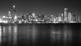 Downtown Chicago Illinois Skyline Stark Winter Monochrome Lake Michigan. Waters of Lake Michigan reflect the light of tall buildings comprising the Chicago city Stock Photos